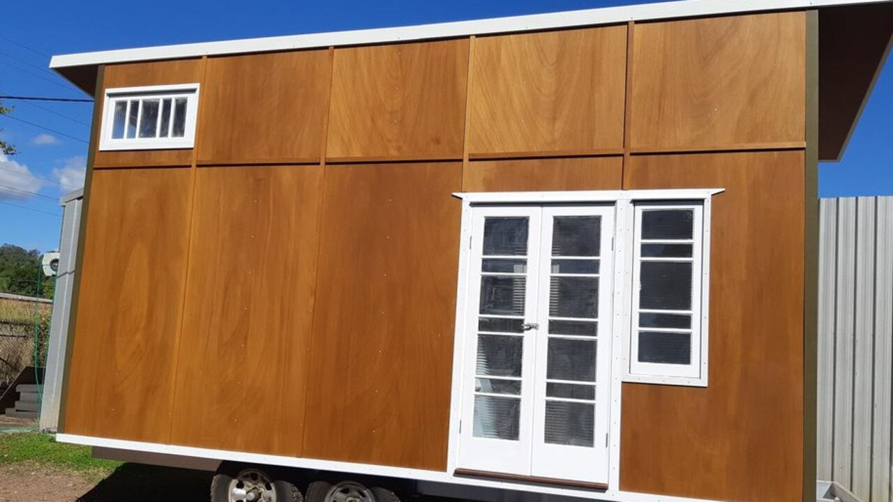 This tiny home, located in Nambour, has strong bones and a small size – able to be towed! All it needs now is an interior fit out.