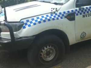 Police vehicle damage during public place shooting