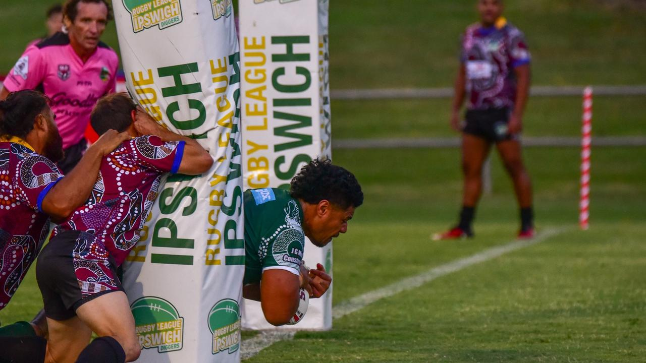 Ipswich All Stars forward Ramon Filipine barges over the line to score his team's first try against the Ipswich Indigenous All Stars at the North Ipswich Reserve. Picture: Bruce Clayton