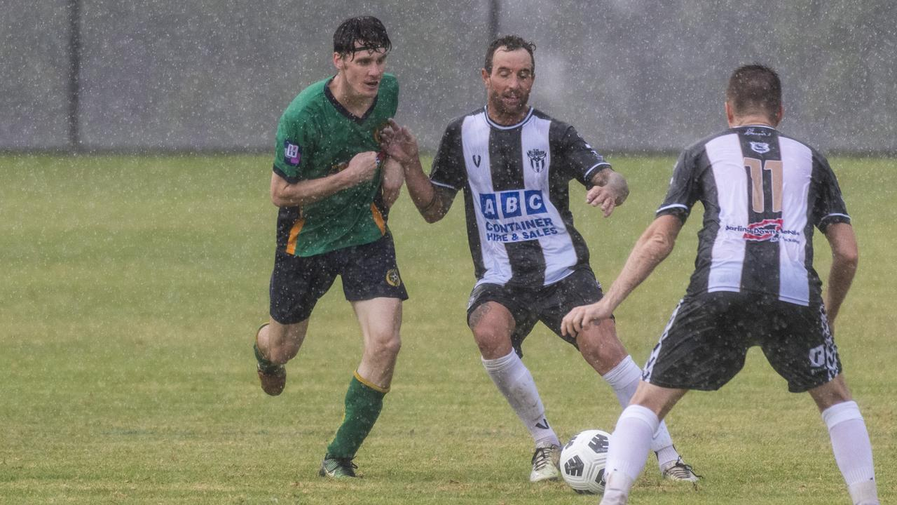 Highfields captain David Mitchell (left) battles for possession with Trent Ingleton of Willowburn during their Toowoomba Football League Premier Men round one clash at Highfields Sport Park. Picture: Kevin Farmer