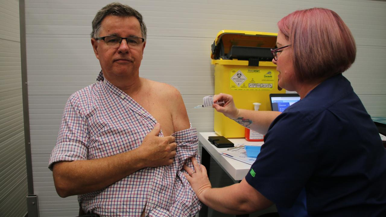 Bundaberg Hospital Intensive Care Unit Clinical Director Dr Doug Wilkinson with vaccinator Sherine Binder. He was the first doctor in Queensland to receive the AstraZeneca COVID-19 vaccine.