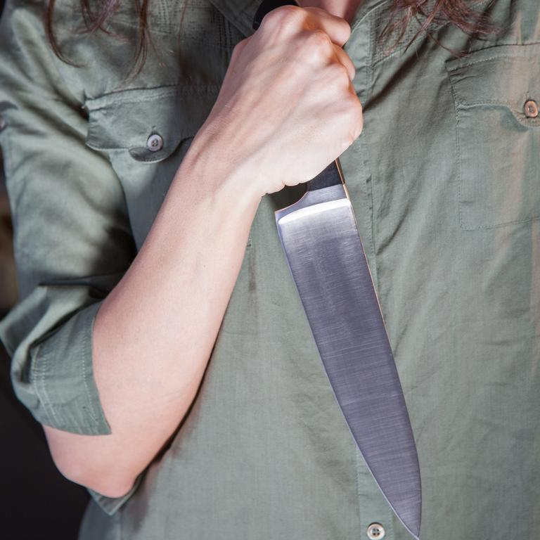 Woman holding knife generic.