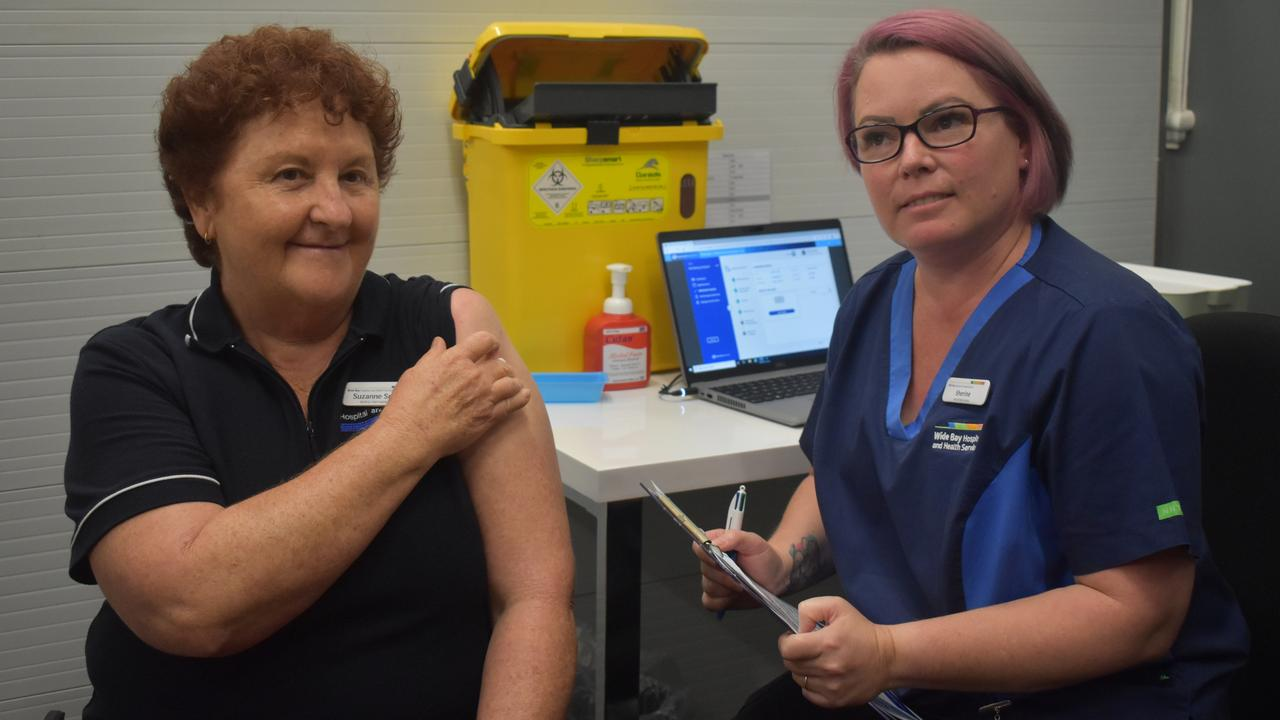 First Queensland recipient of the AstraZeneca COVID-19 vaccine Bundaberg Hospital Emergency Department Nurse Unit Manager Suzanne Smith with vaccinator Sherine Binder.