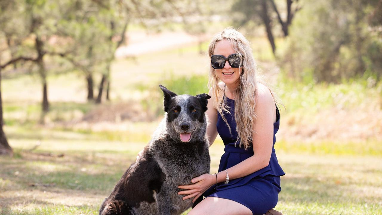 Michelle Reibel and family with their nine-year-old blue heeler cross Diesel, the Gympie's most loveable dog competition winner.
