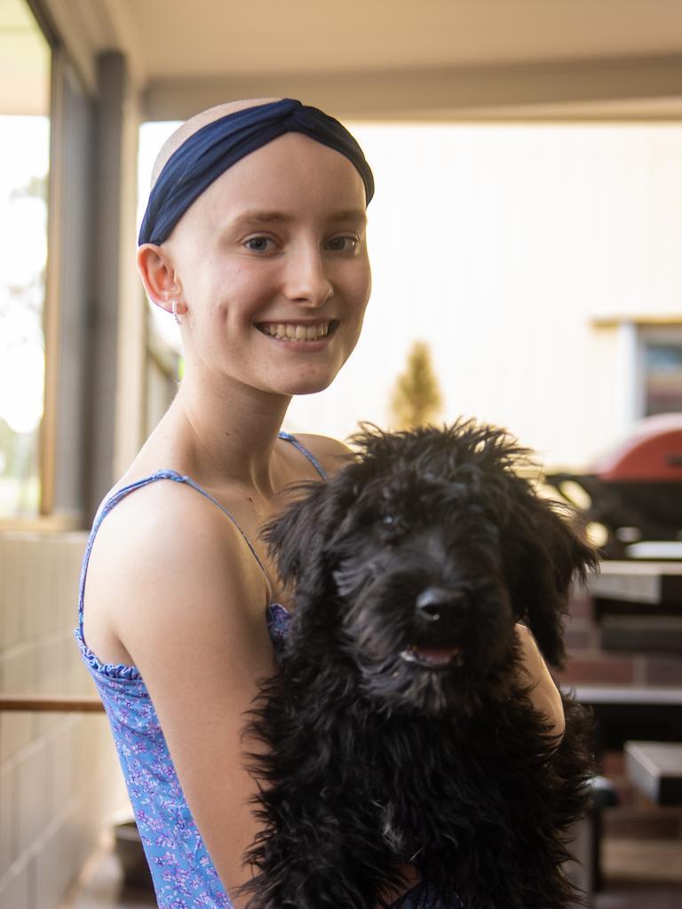 Lockyer Valley teenager Tahlia Utz with her dog Holly. Photo: Ali Kuchel