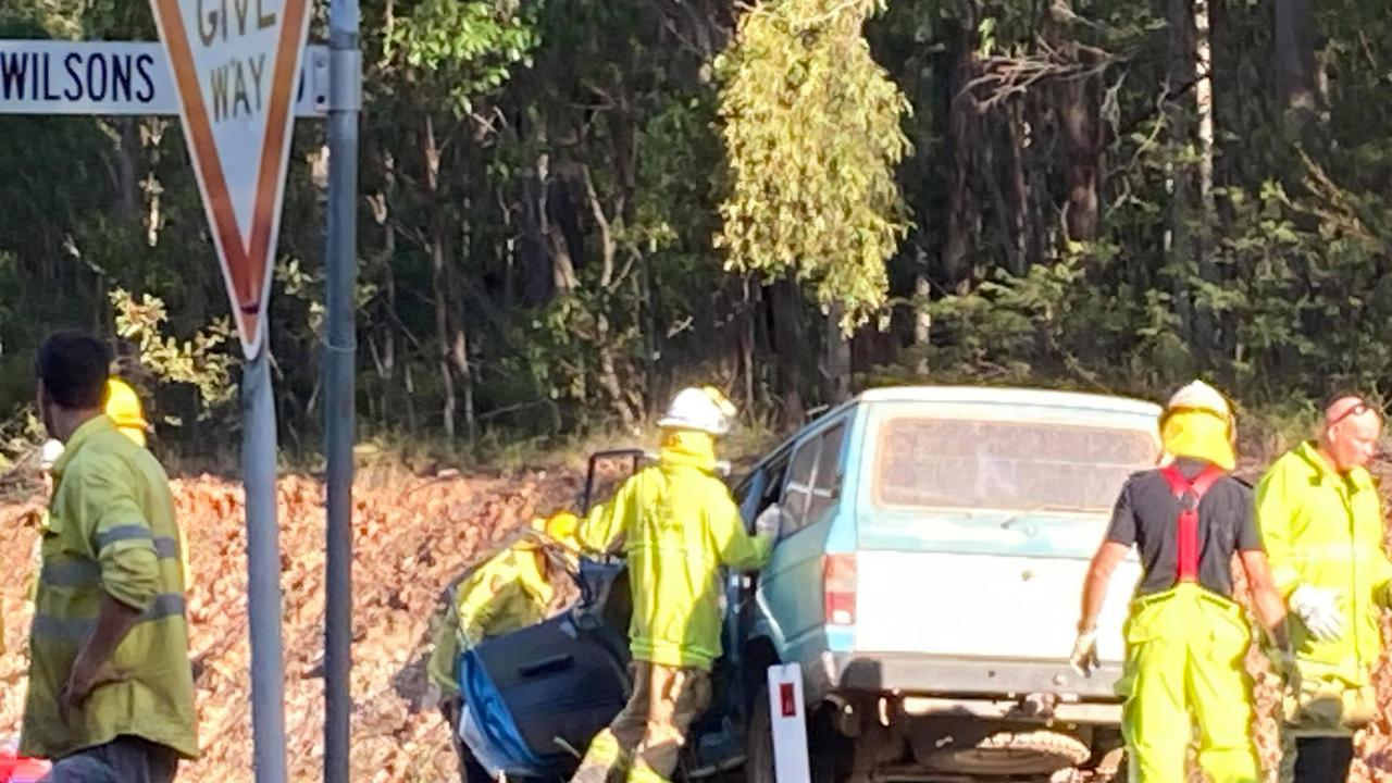 Terrible scenes as emergency workers try to free and work on the two men believed trapped in a ute which was involved in a crash with a full school bus near Gympie on Tuesday afternoon.