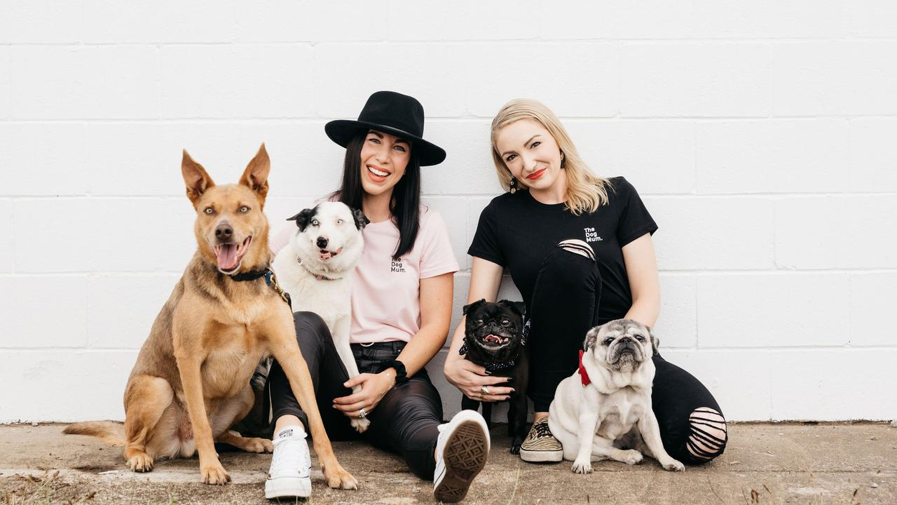 The Dog Mum founder Emma Karanges and director Jasmin Robertson with their four dogs.