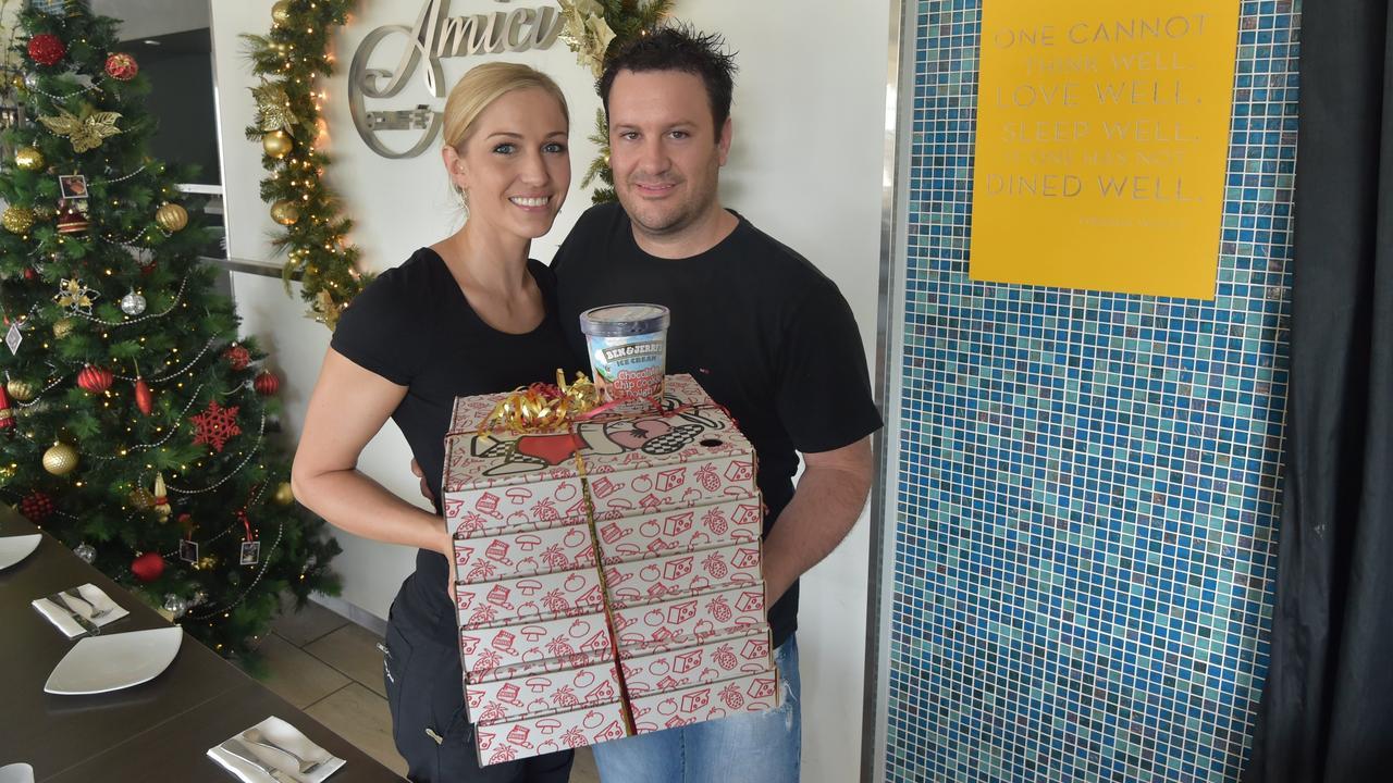 Amici Restaurant owners Sarah Spotz and Jason O'Brien spread some Christmas cheer in 2014. Photo: Brett Wortman