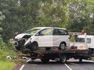 Woman injured as minivan ploughs down embankment