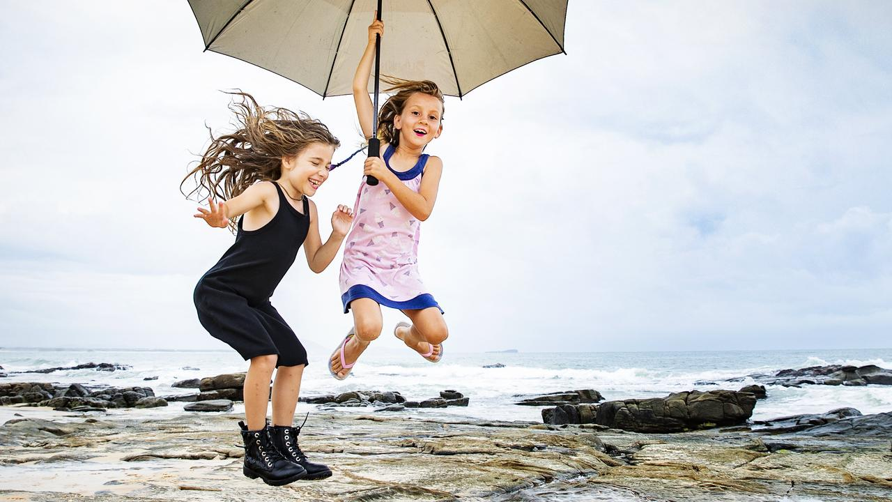 Lexi White and Summer Kelly make the most of a wet day in Mooloolaba. Picture: Lachie Millard
