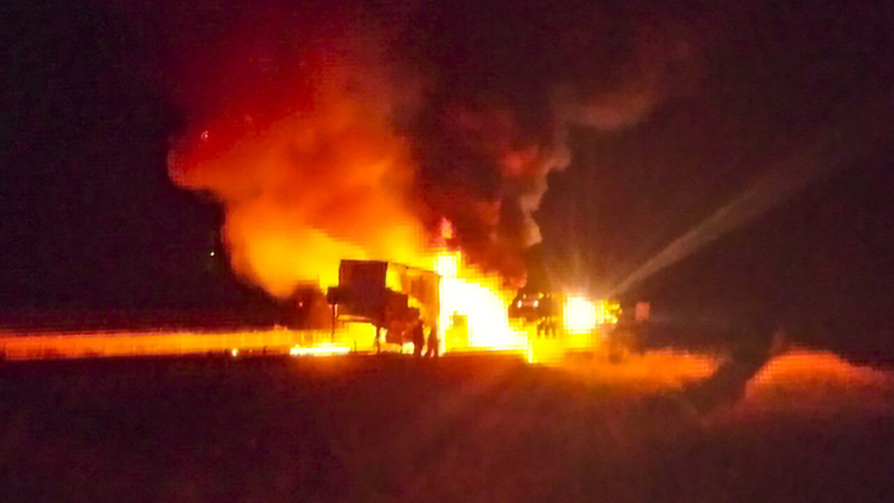 A dramatic images as a truck catches fire heading north on the Pacific Highway near Harwood early Saturday morning.