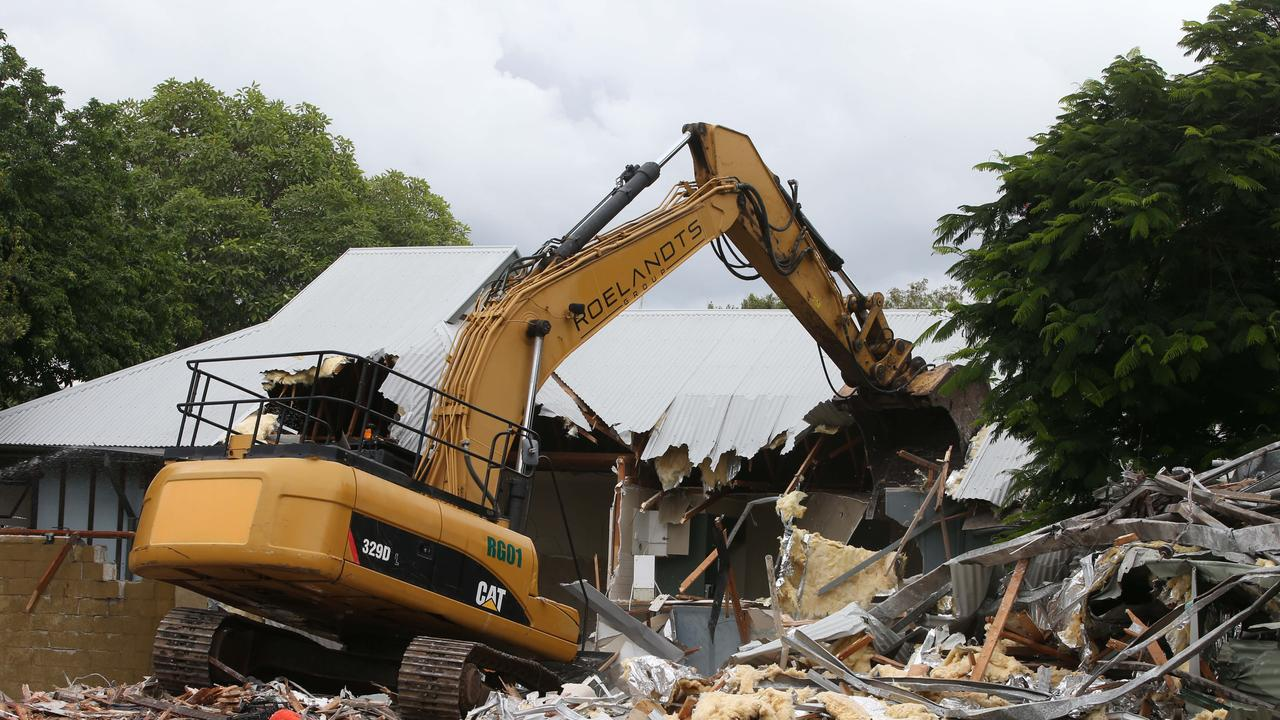 The demolition of derelict houses on the 1.2ha Budds Beach site. Picture Glenn Hampson