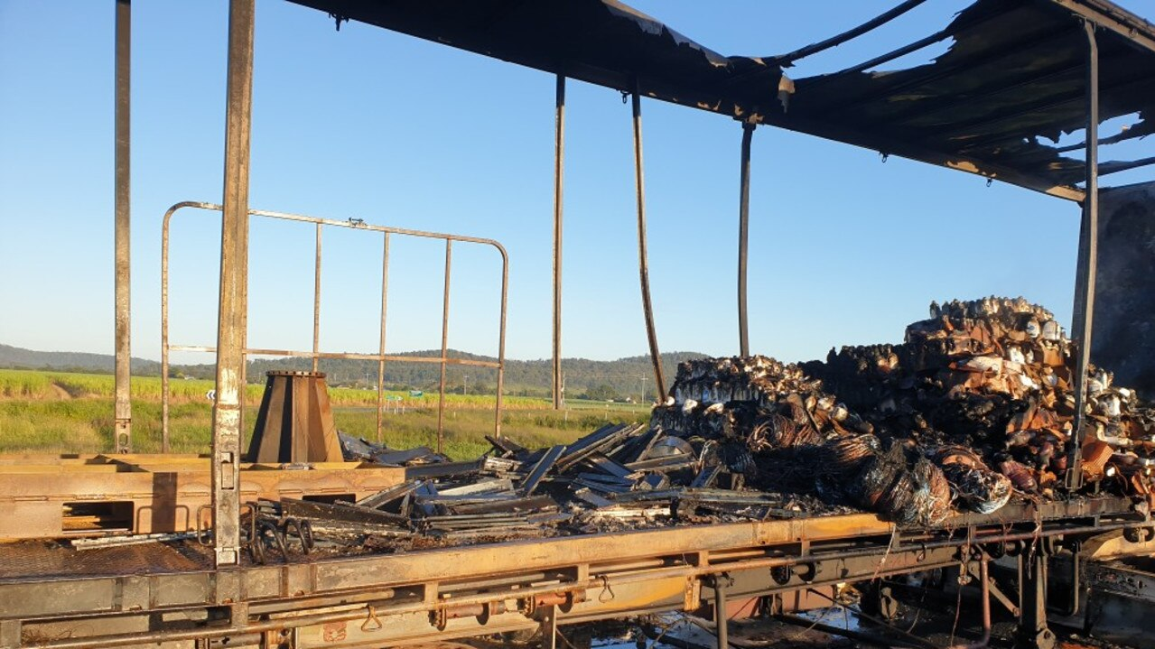 The remains of a truck that caught fire heading north on the Pacific Highway near Harwood early Saturday morning.