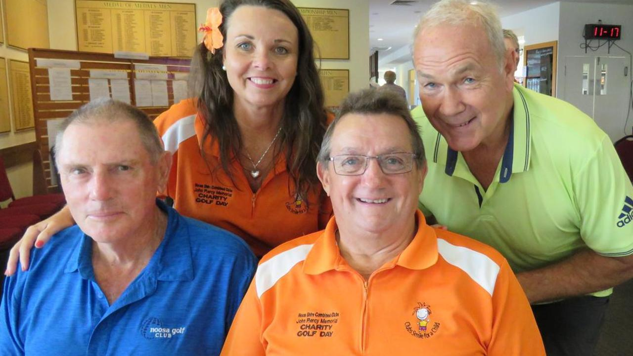 Little Jo Power and Glenn 'Puck' Puckeridge in the orange shirts, with a couple of supporters at the John Piercy Memorial Charity Golf Day.