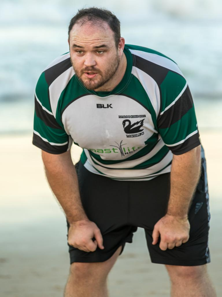 Dale Best on the beach during pre-season for the Maroochydore Swans.