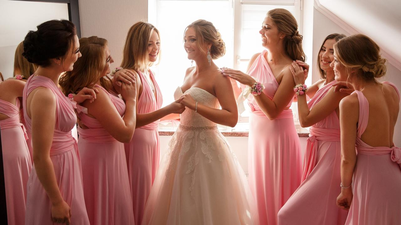 Instead of wearing white, she wore pink and her bridesmaids and the mothers wore white. Picture: iStock