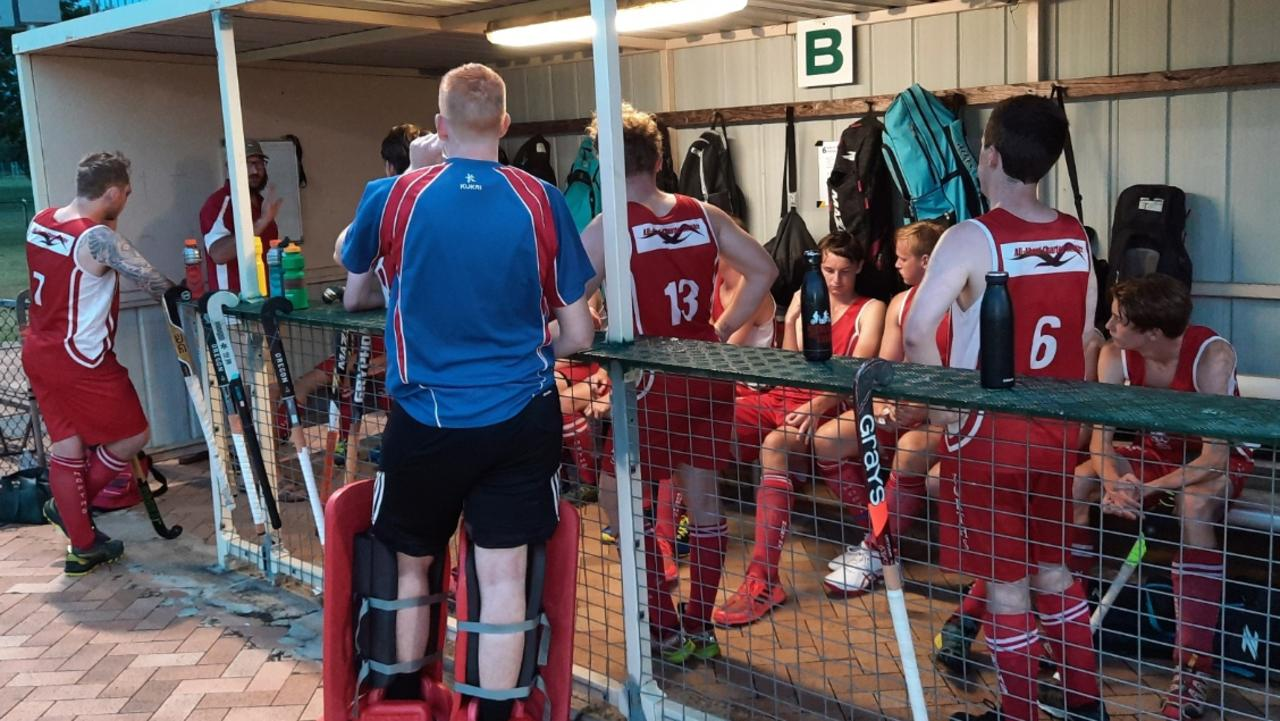 The Norths A-Grade team assess the state of play in Sunday's season-opening match against Easts at the Ipswich Hockey Complex. Picture: David Lems