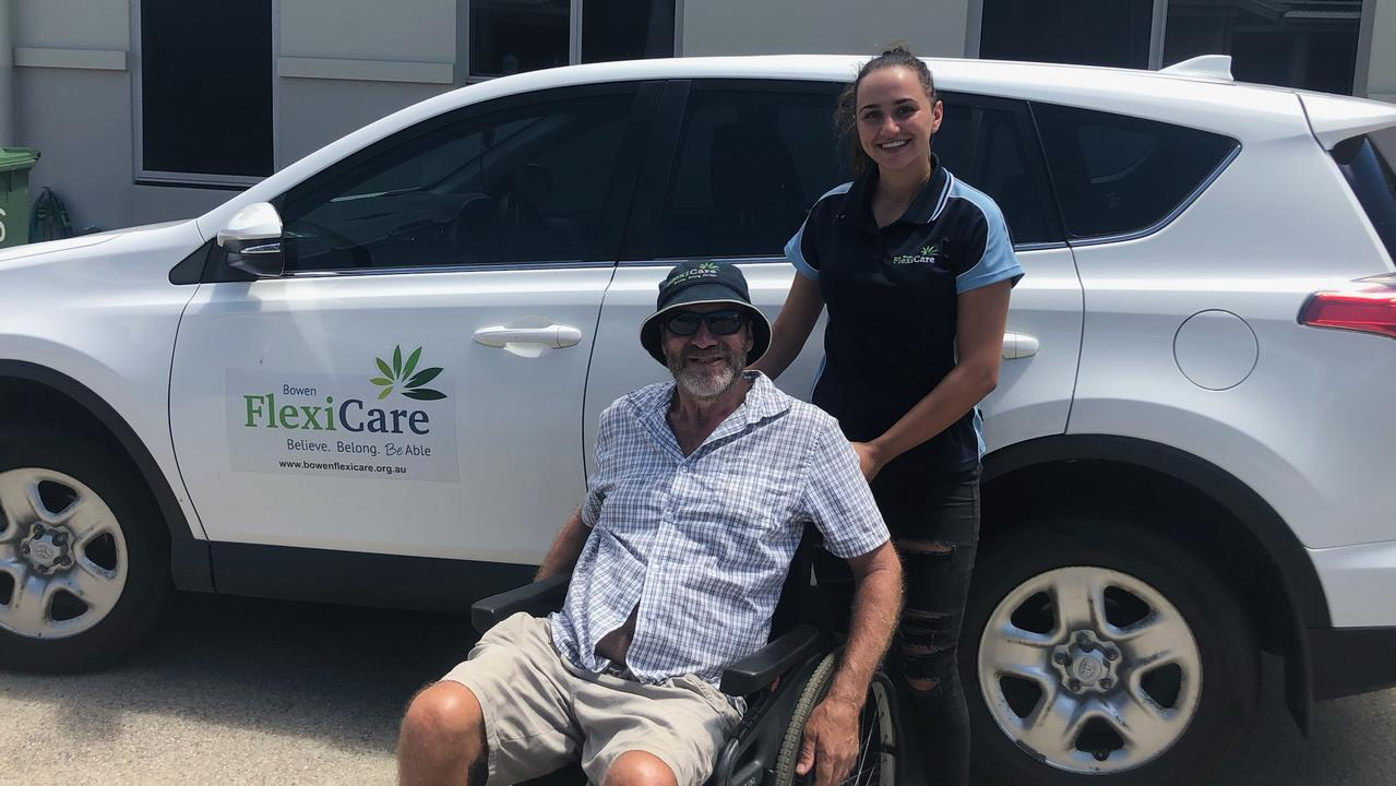 Bowen Flexi Care client Ray Halls and staff member Shannon Colquitt. The support service just scored funding from the QCoal Foundation. Photo: Contributed