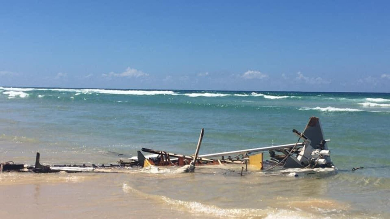 A boat was smashed to pieces by waves in just one night near Double island Point on the weekend. Photos: Clayton's Towing