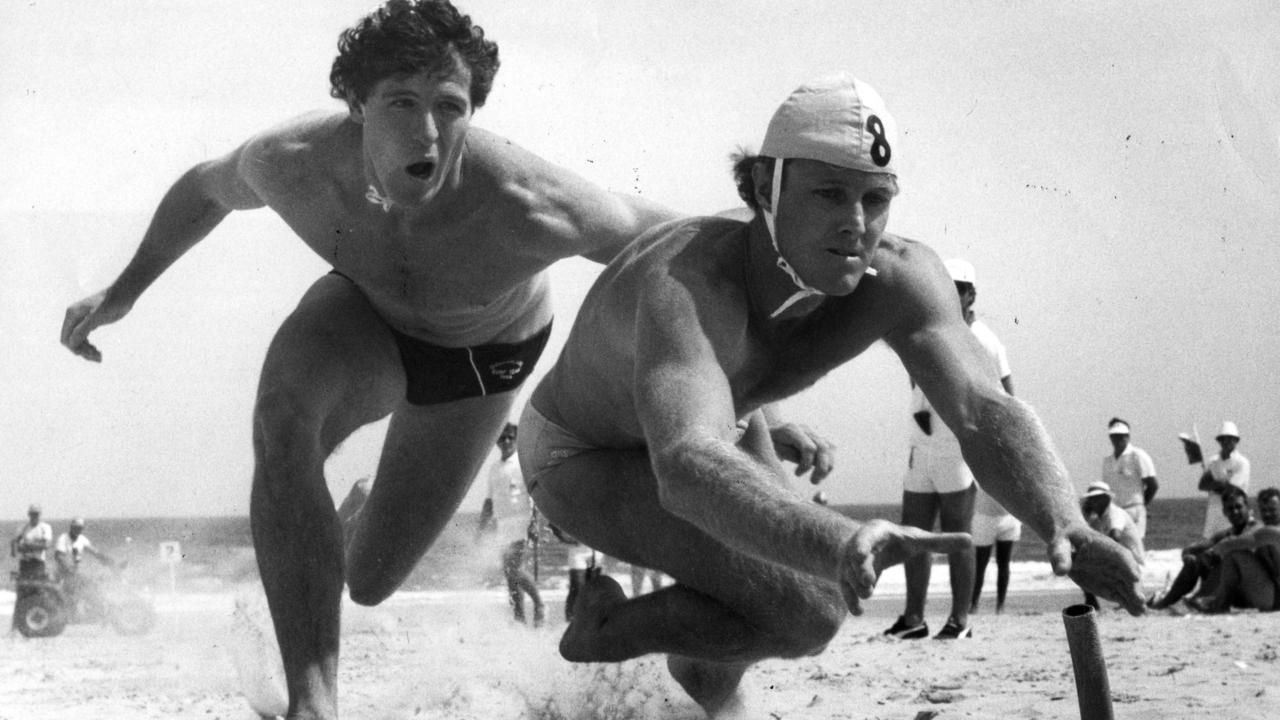 Warren Peters (left) in the final of the interstate beach flags event at the Australian surf lifesaving championships at Moana 20 Mar 1985.