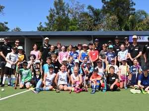 Labradors, Kookaburras share skills at hockey clinic