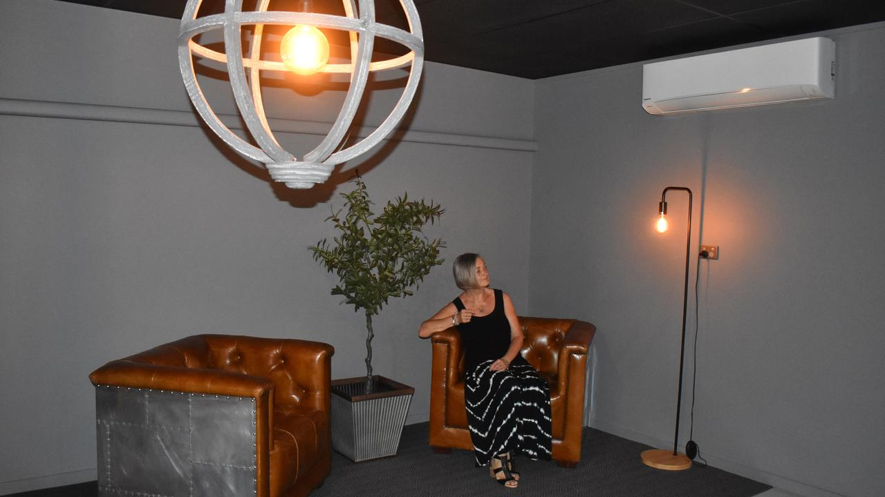 Escape Grid owner Beth Scott sits in one of the waiting rooms of the Bundaberg East business. Picture: Rhylea Millar