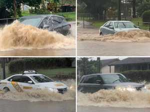 WATCH: Drivers venture into flood waters to save minutes