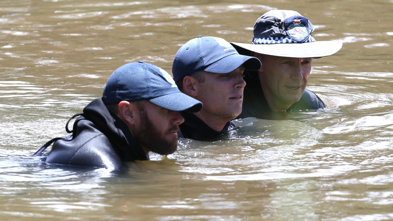 Police divers during the search for the body of Tiahleigh Palmer in the Pimpama River. Picture: Regi Varghese