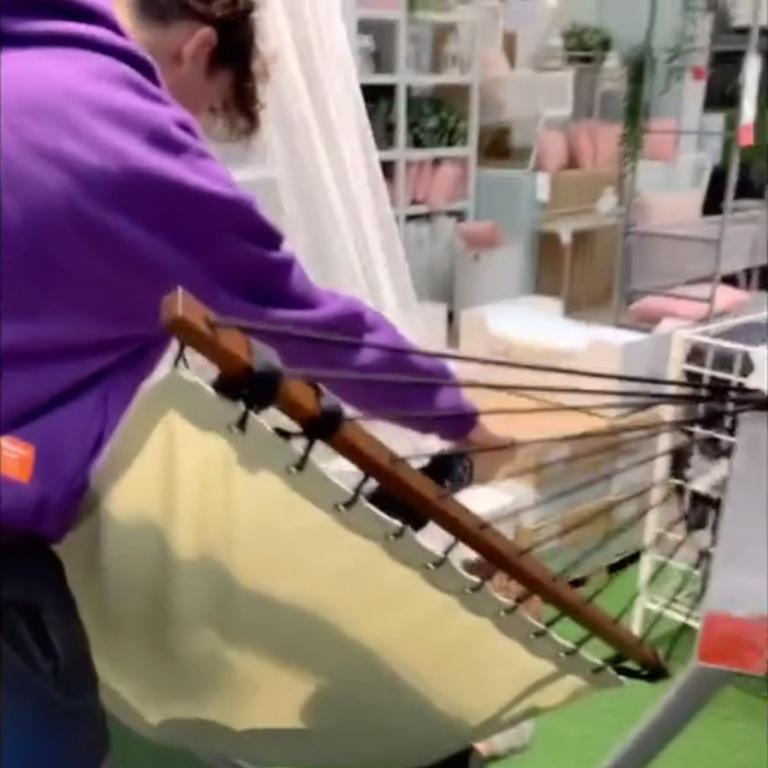 The pair filmed themselves wandering around the store and playing in display hammocks. Picture: Tik Tok