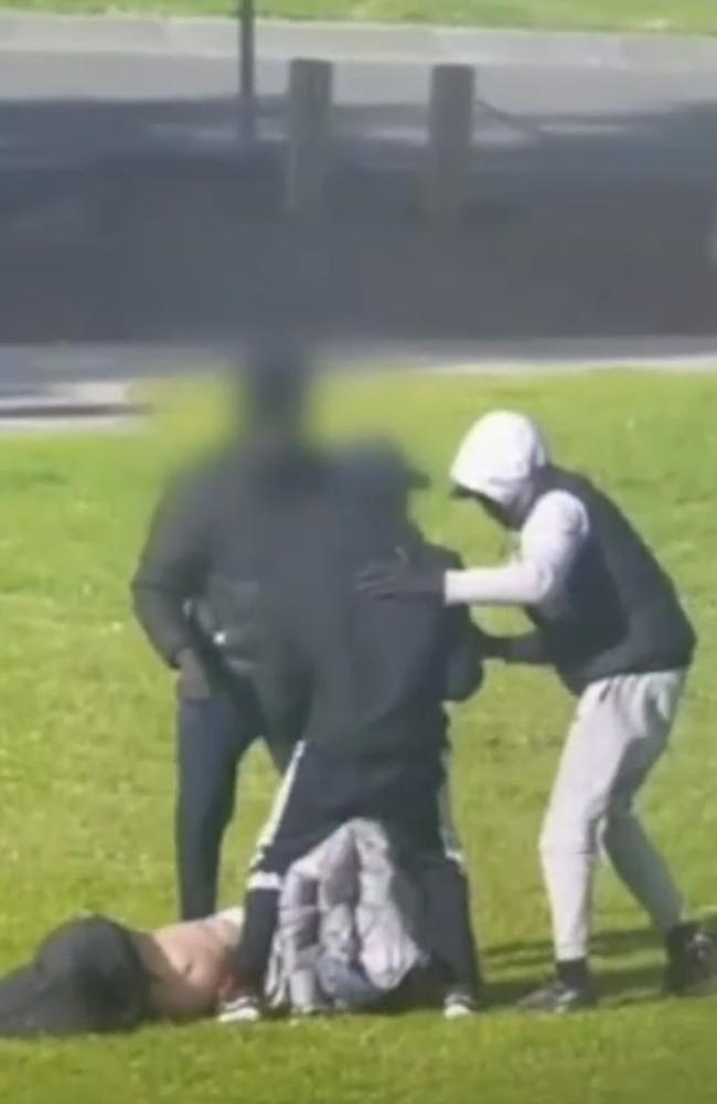 The 63-year-old was set upon and dragged onto the oval. Source: Nine News