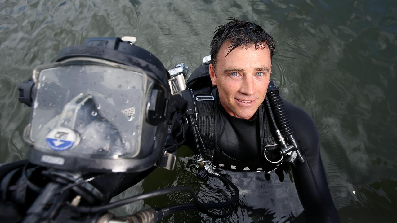 "Senior Constable Michael Turner says the dive squad are a ""unique bunch"". Picture: Steve Pohlner"