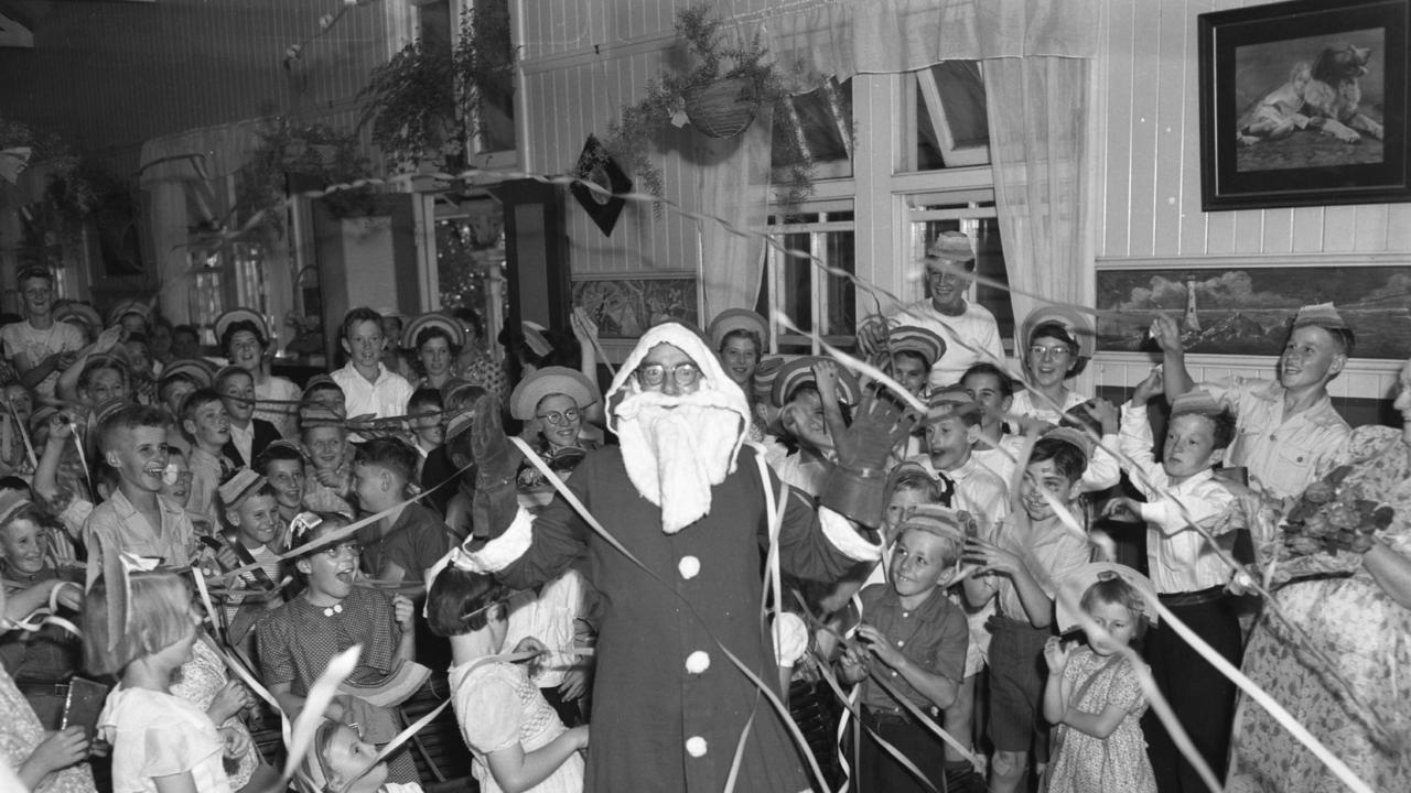 Children at the Dutton Park State School received a visit from Santa just before the start of school holidays in 1950. Picture: Norm Lye