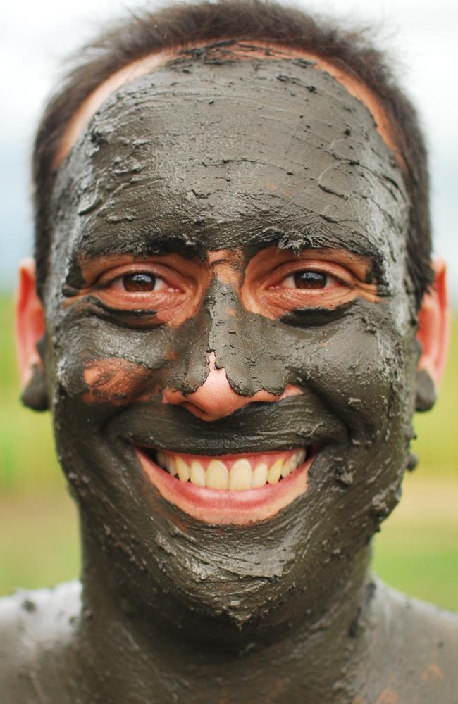 Brisbane based travel blogger Anthony Bianco having a mud bath in Fiji, near Nada, in 2010.