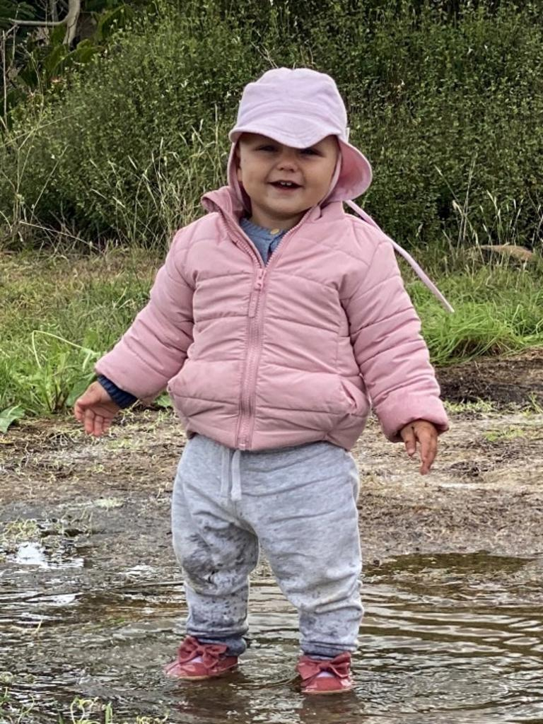 Isabell Moss, of Yass, celebrated her first birthday with a good splash in the puddles.