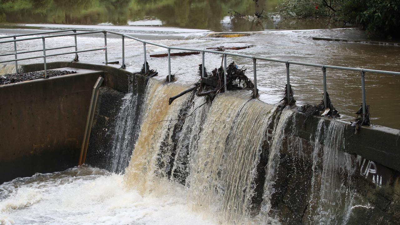 Parramatta Weir was overflowing. Picture: David Swift