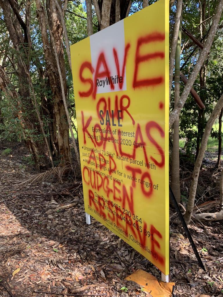 Graffiti over sale sign in Bogangar on a lot for sale in koala habitat.