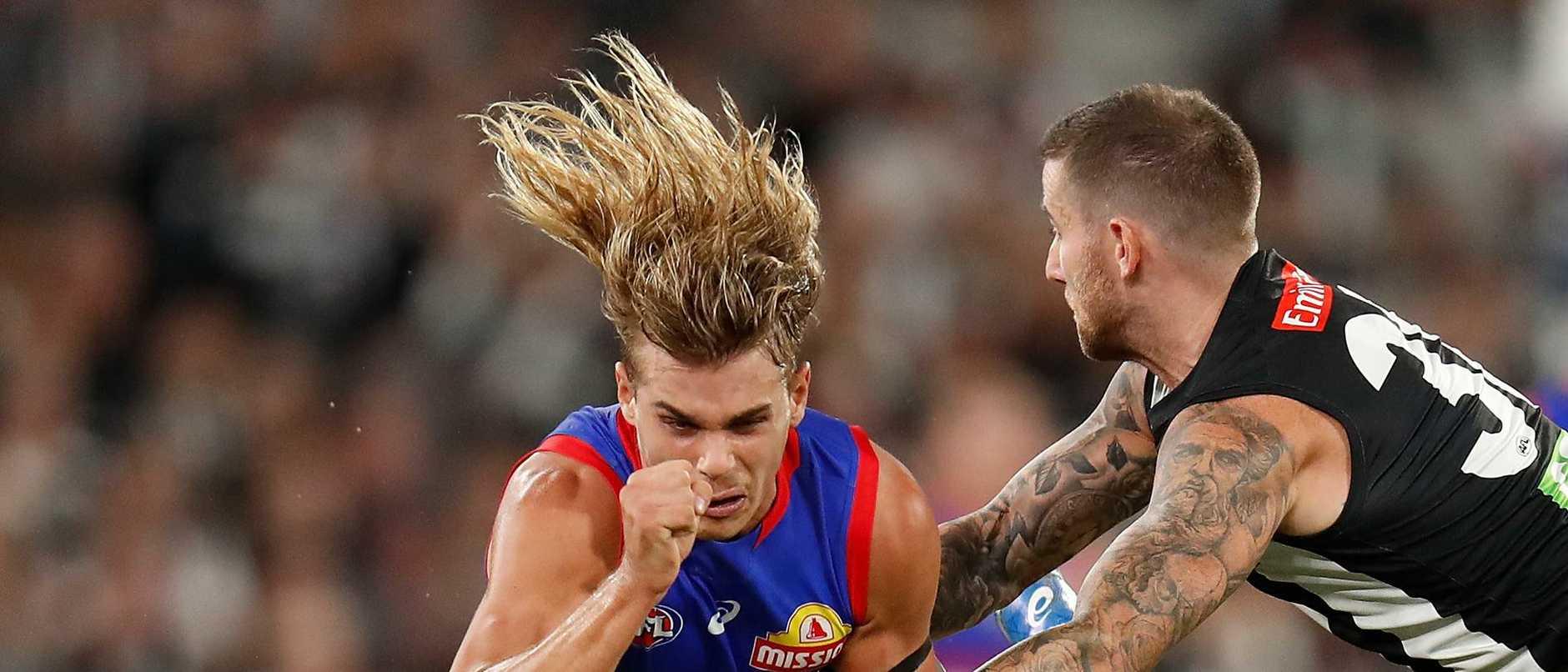 Footy photographer Michael Willson has added to his portfolio of stunning shots, capturing Bulldogs midfielder Bailey Smith in full flight — literally.