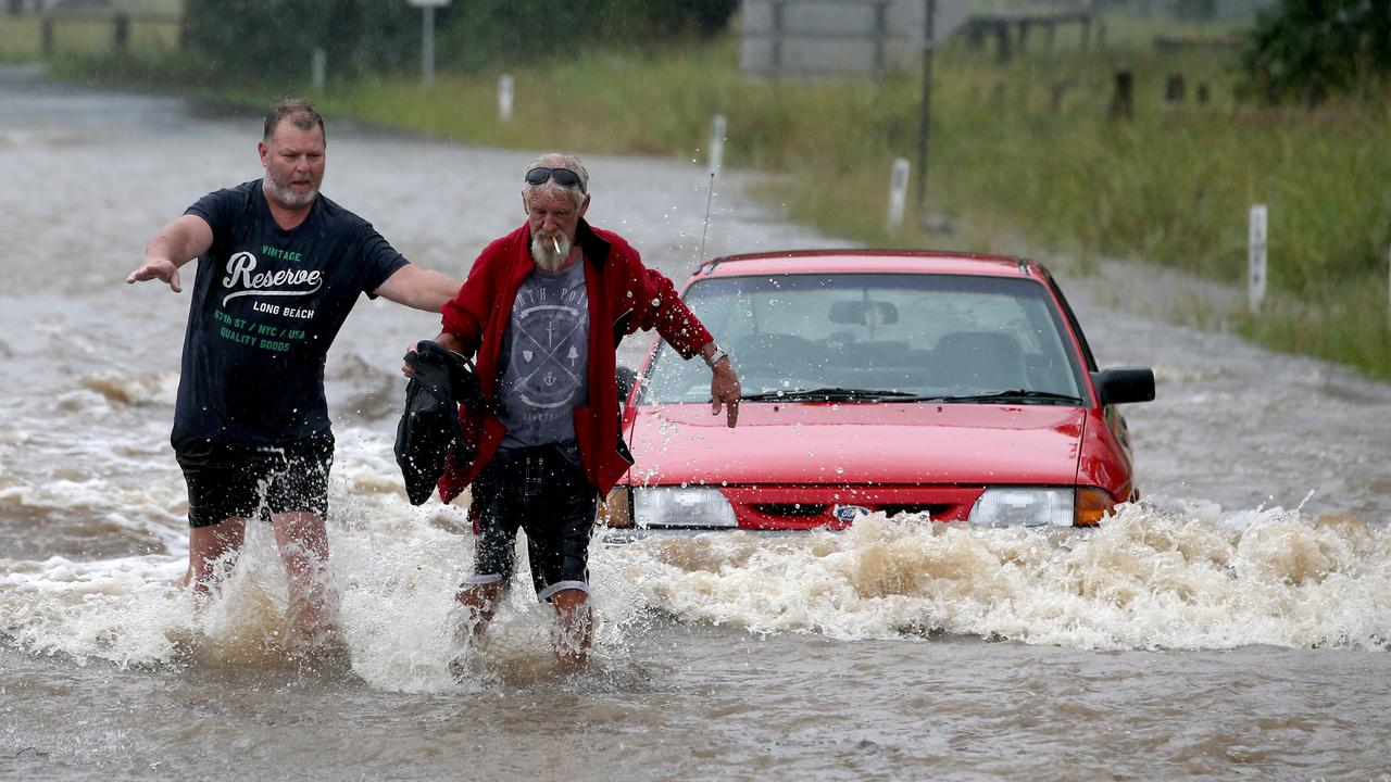 The driver was rescued by locals as it is inundated with flood water. Picture: Nathan Edwards
