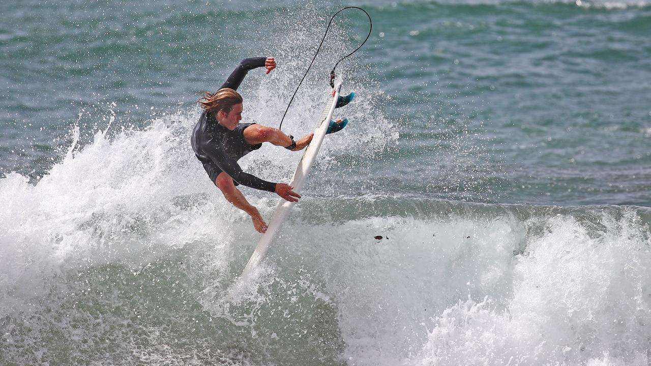A surfer catches a wave at Collaroy on Friday. Picture: Toby Zerna
