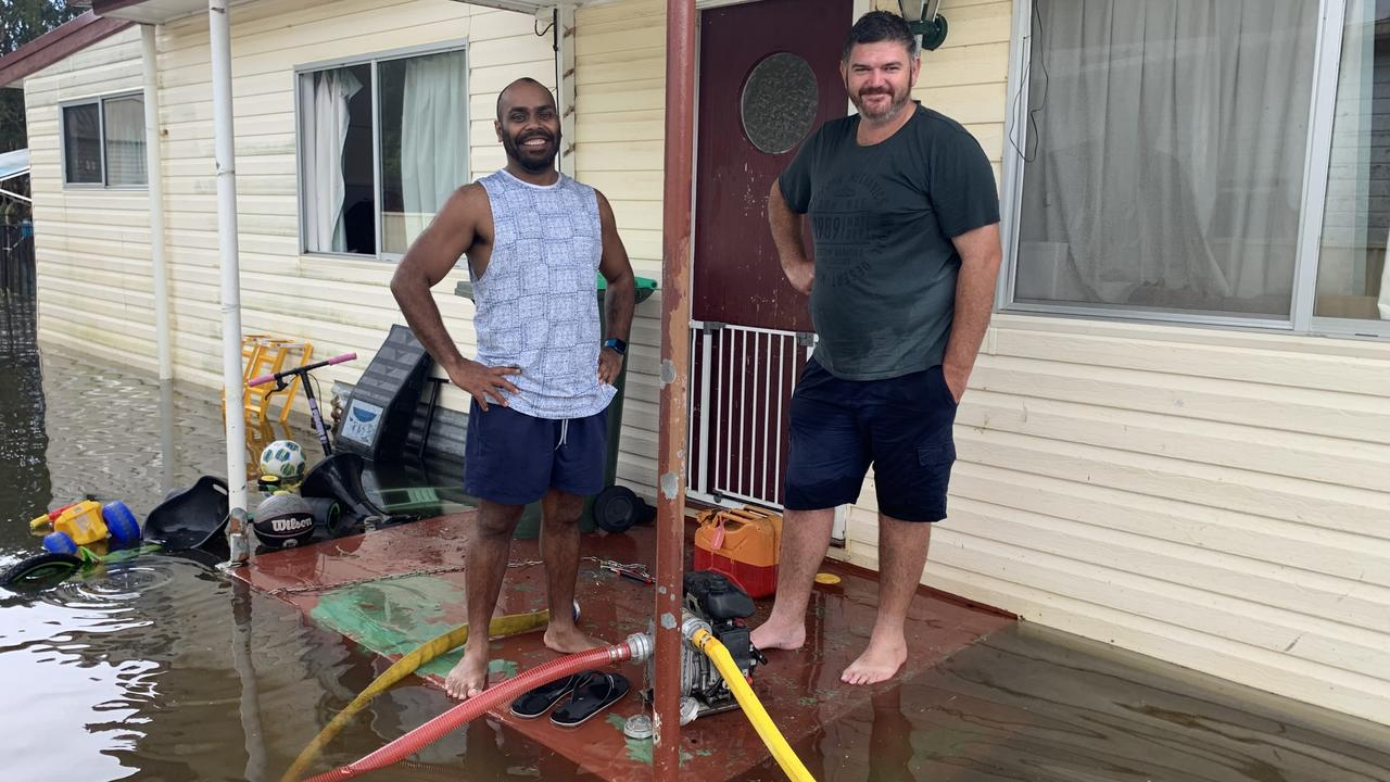 Francis Nahow and the man who saved his home from bushfires, Rob McPherson, on the porch of Mr Nahow's home. Picture: Supplied