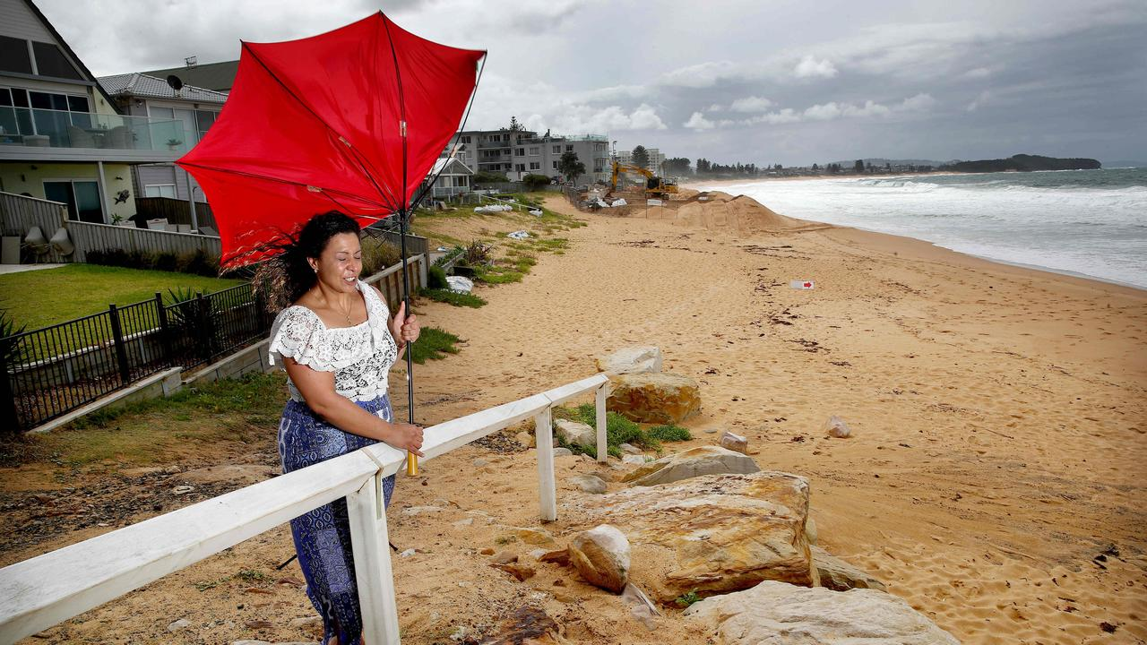 Monica Mark struggles against Sydney's torrential rain and wild weather. Picture: Toby Zerna