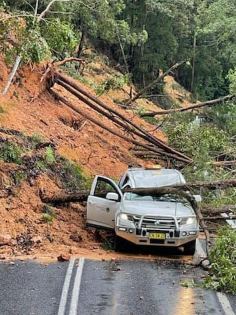 Heavy rainfall triggered a landslide leaving a car stranded at Dorrigo.