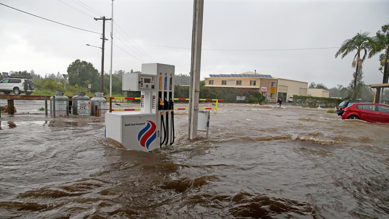 A petrol station at Telegraph Point was inundated with flood waters on Friday evening. Picture: Nathan Edwards