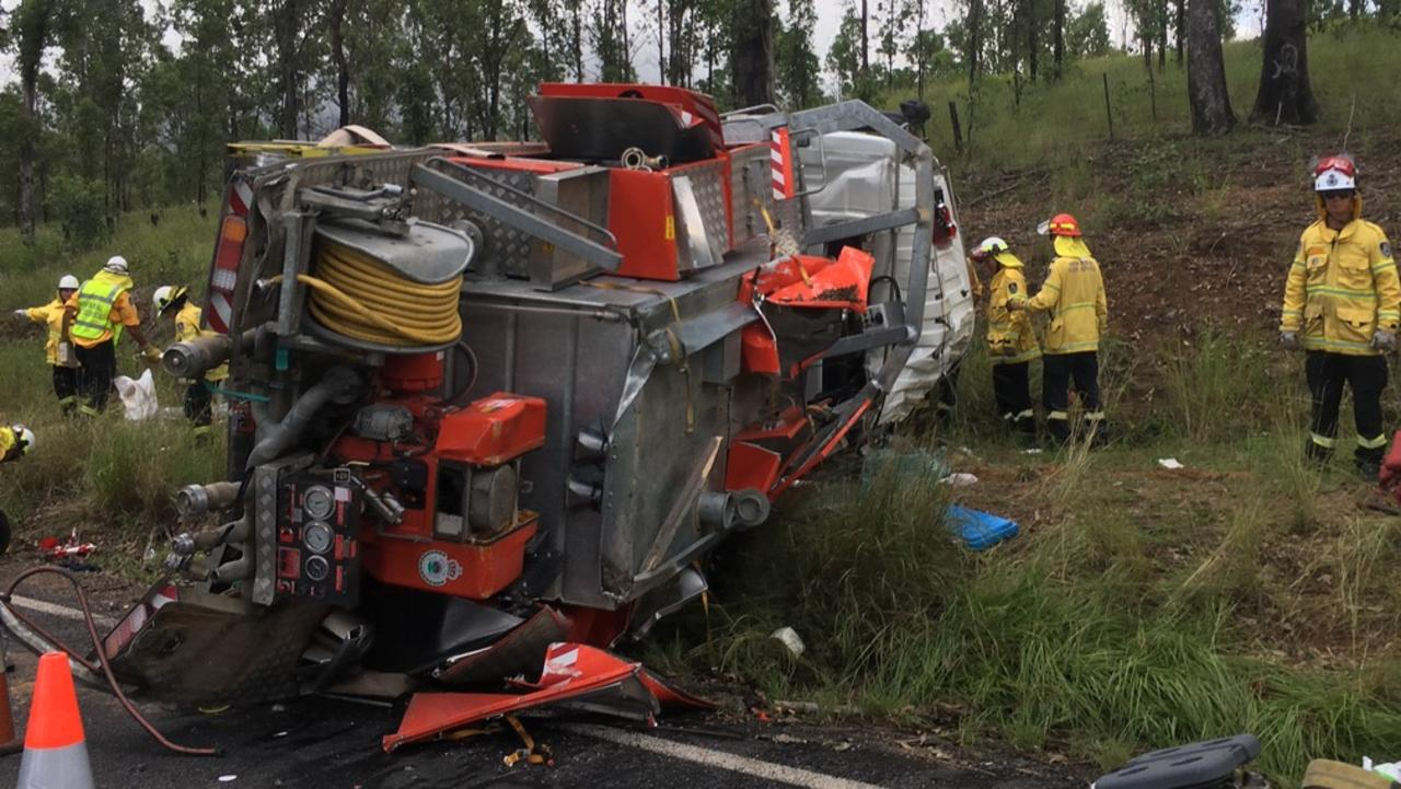 An RFS truck from the North Coast crashed into a truck and rolled on the Gwydir Highway on Friday. While the four crew were able to escape serious injury, two were taken to Glen Innes hospital with minor injuries. Photo: Graham Mackie