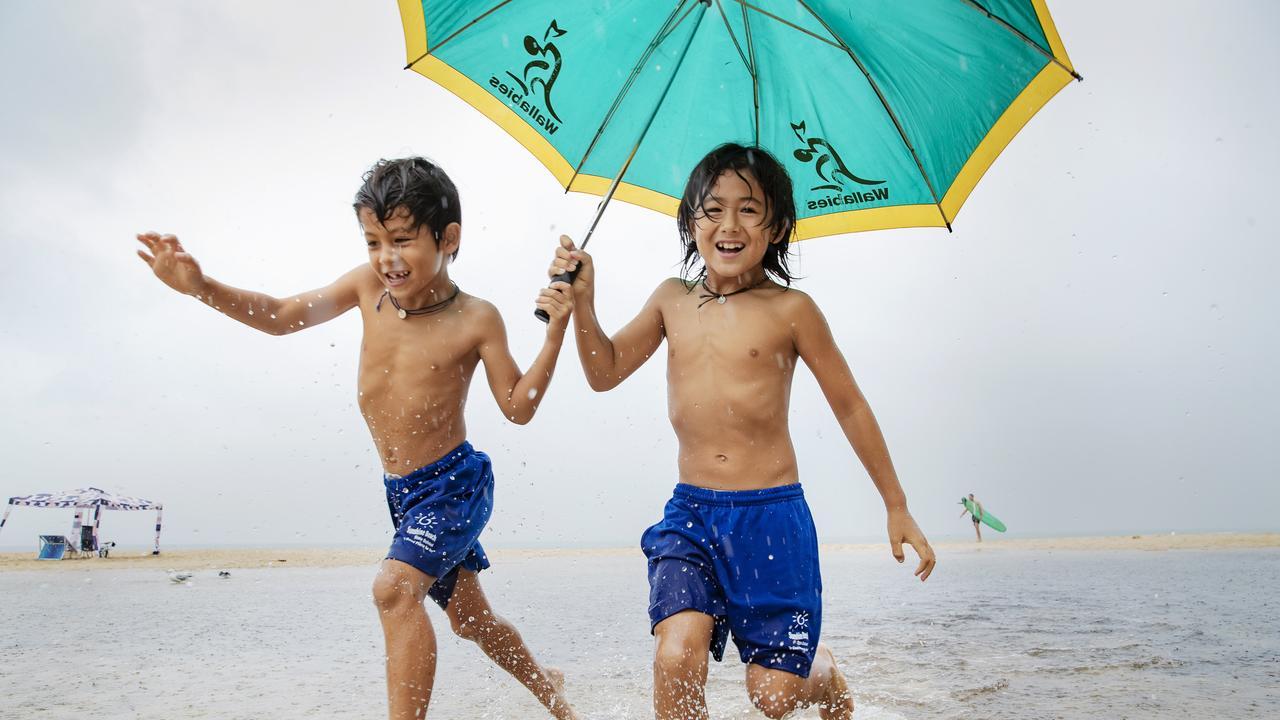 Noosa locals Amo 7, and Hakumi Turran 10 brave the rain for a surf check earlier in March. Photo: Lachie Millard
