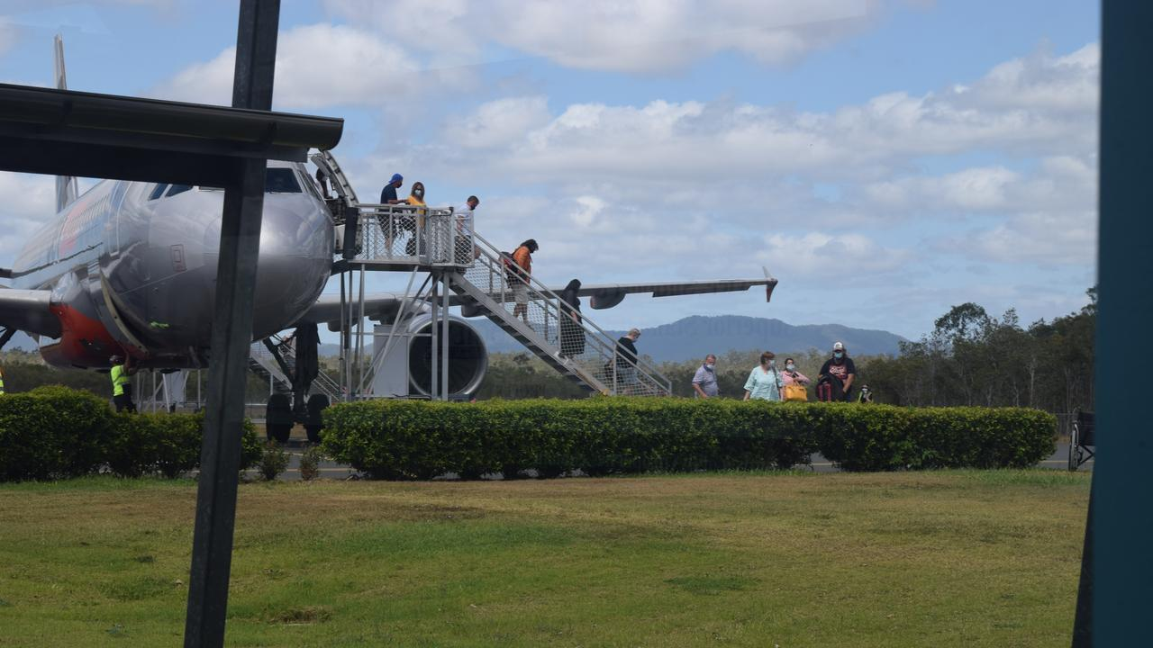 Passengers disembark a flight at Whitsunday Coast Airport. Picture: Laura Thomas