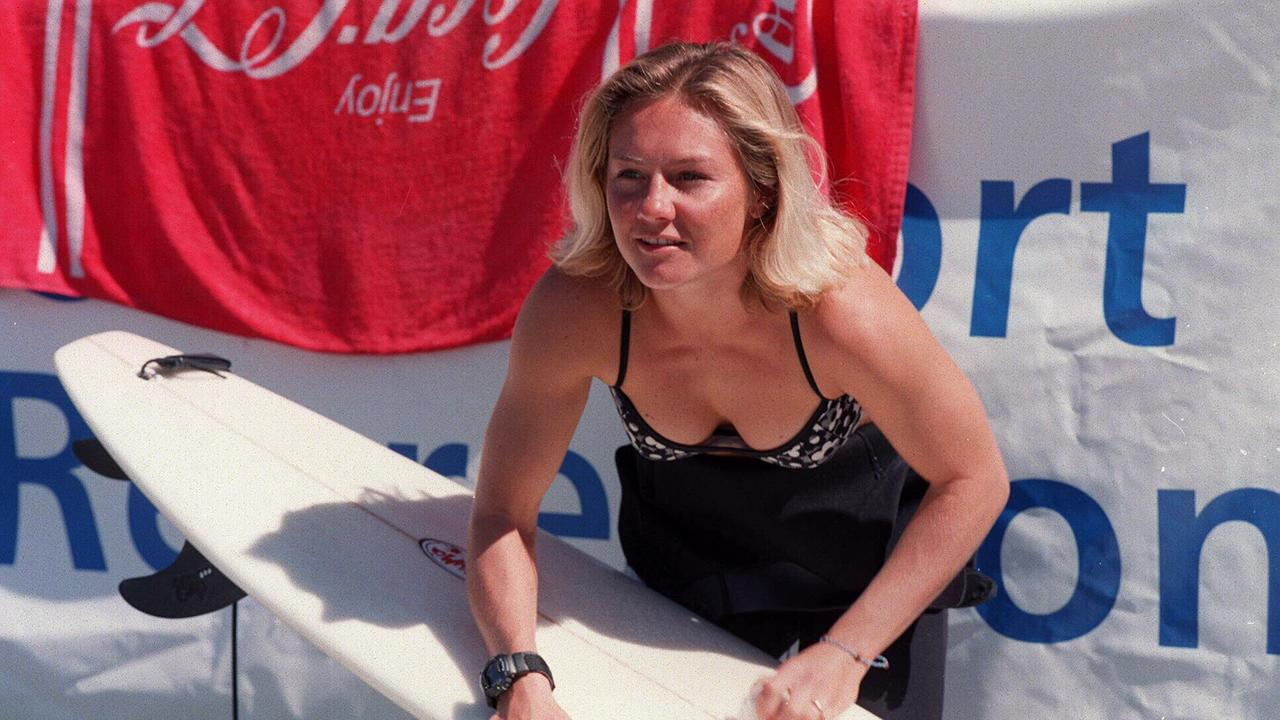 Surfer Rochelle Ballard waxes her board at 1997 Cleanwater Surf Classic at Manly Beach./