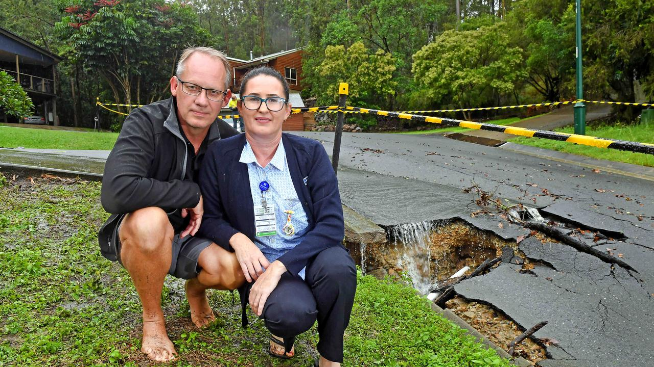Boxer Ave residents Brian and Nicky Potterton next to the damaged Shailer Park road. Picture: John Gass