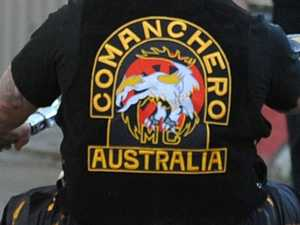 Alleged bikie associate charged over knuckle dusters, pills