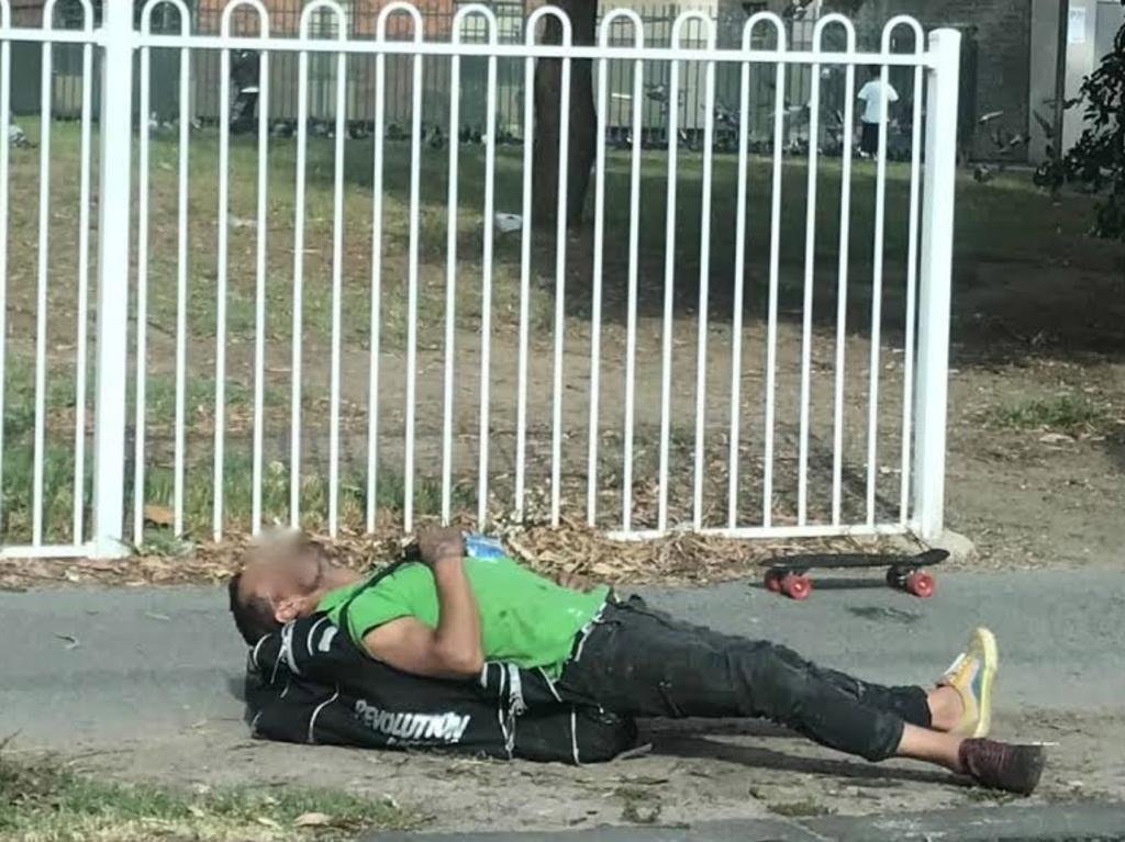 A man motionless on the ground near the injecting room. Picture: Supplied